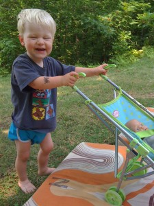 E pushing toy stroller, Camp NeeKauNis