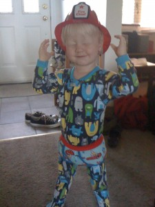 E in the fire chief's hat and monster pjs